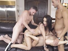 Two remarkable babes are having a foursome on someone's skin couch