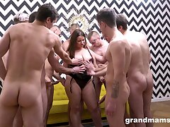 Scant mature enjoys several dicks in a serious gangbang tryout