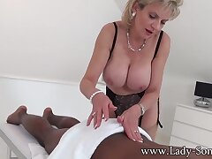 British Mature domina Lady Sonia in interracial massage - femdom massage