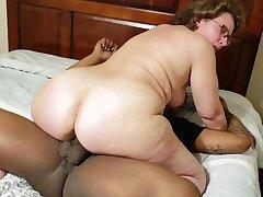 Busty mature grandma close by big brim-full with homemade interracial hardcore