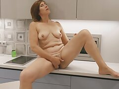 Mature have a hunch fucks in the kitchen for a hot solo