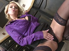 Blonde MILF Lucy Angel gets a doggy style fuck in the kitchen