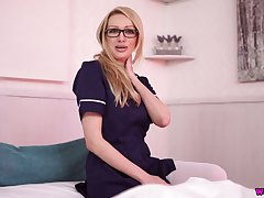 Amazing auburn nurse Amber Jayne has a fake cock to wank a bit