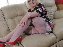 Nerdy busty mature blonde amateur Claire Knight fingers her pussy