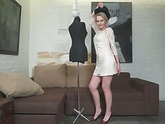 Mature blonde Artemia gets naked and plays with her yummy muff