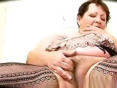 Heavy Granny Enjoying A Chubby Black Cock