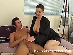 Brunette amateur MILF exposes her huge interior and gives a handjob