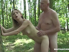 Outside sex plus blowjob in the forest are financial stability by no manner of means of Lily Girder