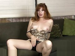 Curvy mature Amber Dawn seductively rubs her pussy