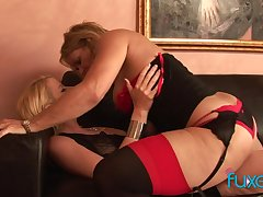 Curvaceous temptress of a MILF fucks a pretty young woman all round a strap-on