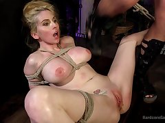 Video of busty blonde Christie Stevens tied up increased by rough fucked